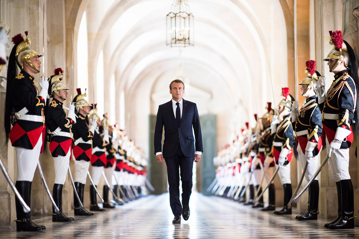 French President Emmanuel Macron walks through the Galerie des Bustes (Busts Gallery) to access the Versailles Palace's hemicycle for a special congress gathering both houses of parliament (National Assembly and Senate) in the palace of Versailles, outside Paris, on July 9, 2018.