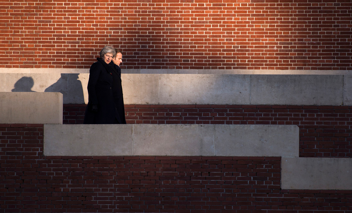 British Prime Minister Theresa May and French President Emmanuel Macron tour the Thiepval Memorial on November 09, 2018 in Thiepval, France.
