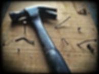 repair-black-claw-hammer-on-brown-wooden