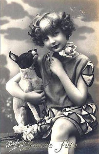 a girl with a toy fox terrier in black and white