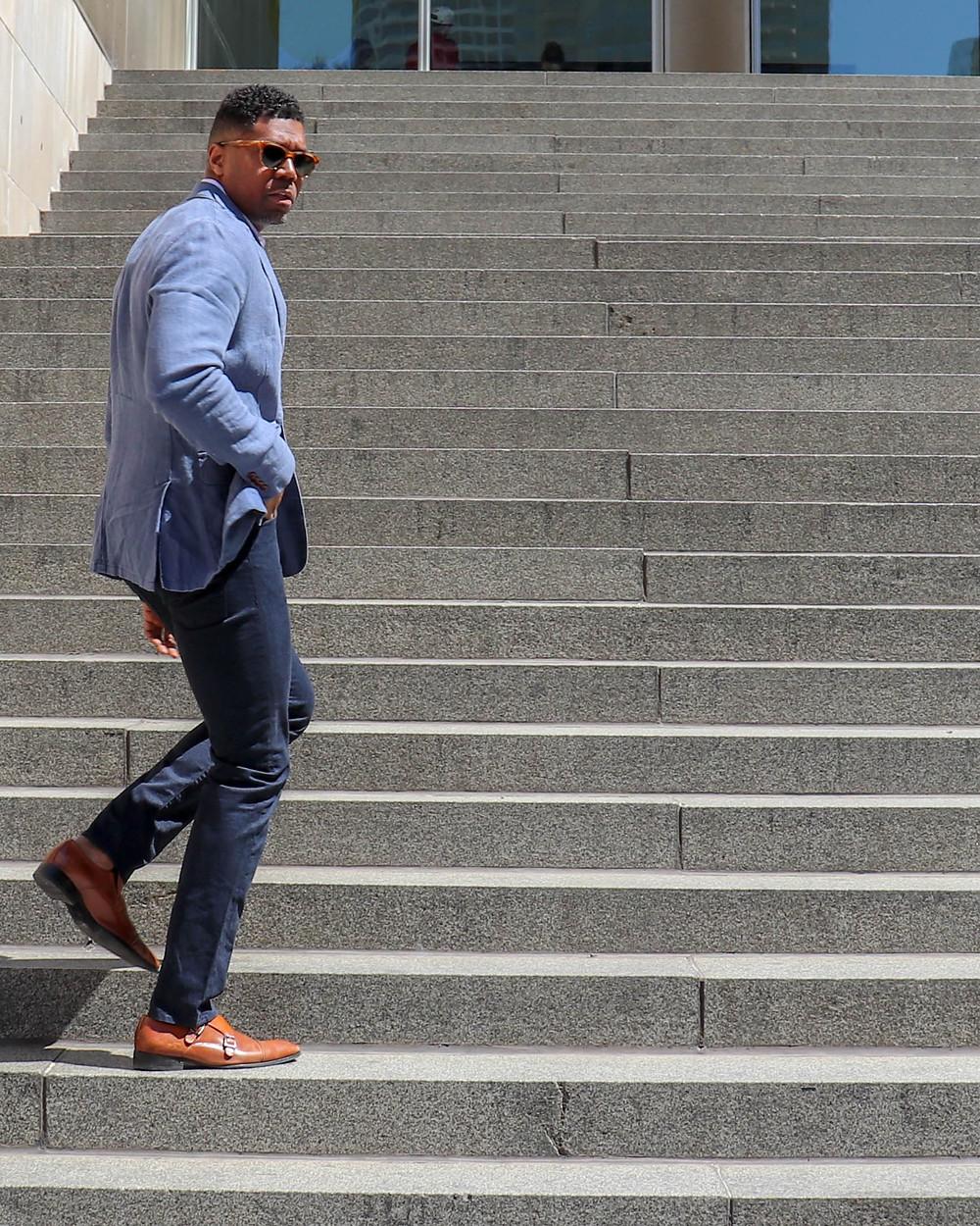 man in blazer on steps