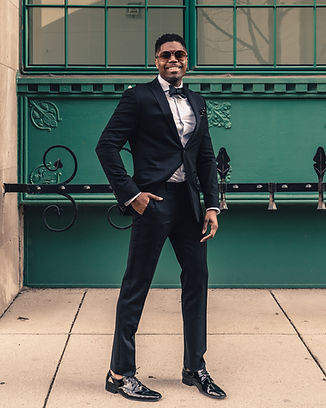 Man in black tuxedo and bowtie