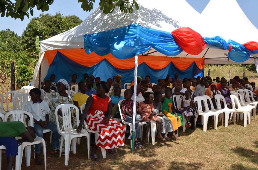 Here we see the children gathered and in preparations to start the prayers which were led by the area church priest. We always start with prayers and thanks giving giving to God for enabling us go through a year. We always appreciate God's protection and the provision through out the year and we use this very function to pray for our supporters