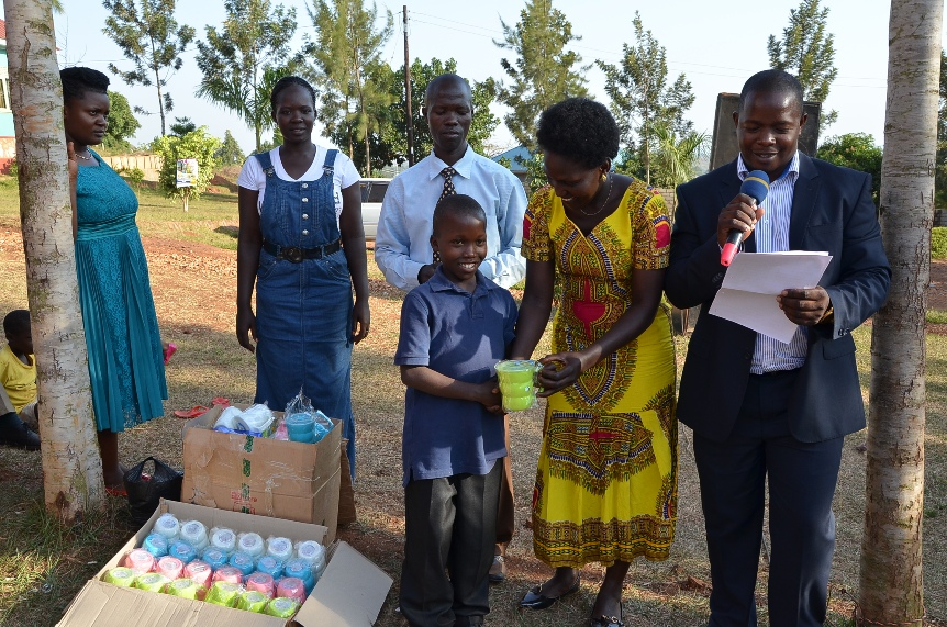 Some of the children who performed very well in the final exams being rewarded.