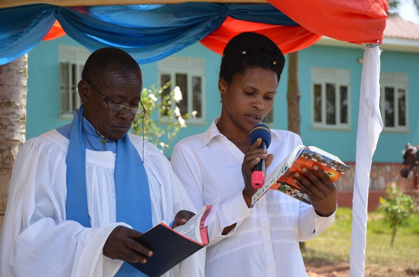 The priest from St.Mark Church of Uganda leading us in the prayer service on the day of Christmas and new year celebrations.
