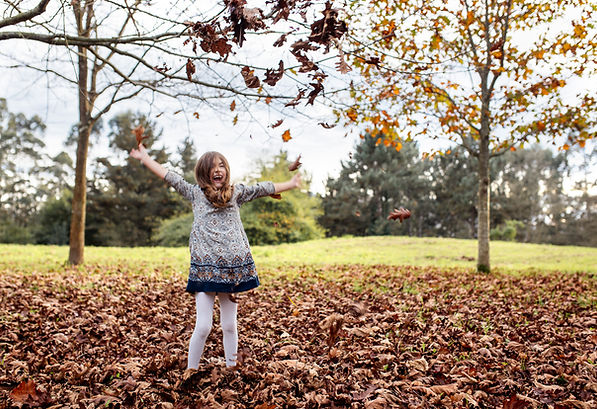 girl dress falling leaves