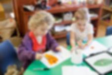Preschool children painting at our kindergarten in Avondale
