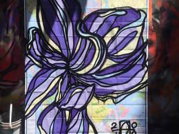 New York Iris by Andrea LaHue aka Random Act, Spray paint on an upcycled  New York Map
