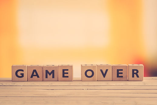 Game over sign on a table in retro color
