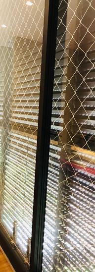 rede proteção para porta sacada.jpeg