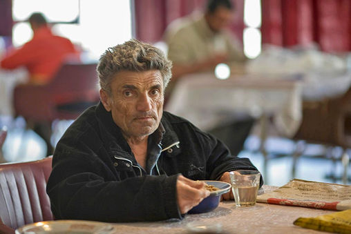 seated-man-at-soup-kitchen.jpg
