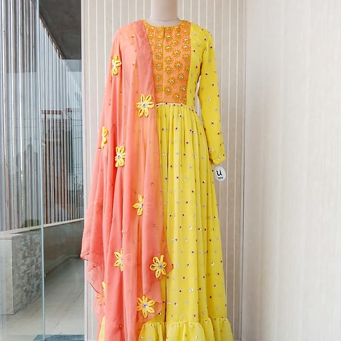 Bright yellow Anarkali suit with floral embroidery and applique floral dupatta
