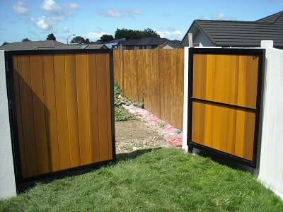 Double swinging cedar clad gates (open)
