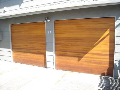 Matching_horizontal_cedar_tilt_doors_1