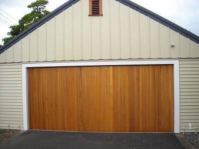 Vertical cedar tilt door.