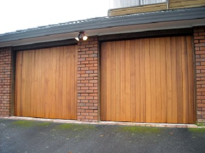 Double vertical cedar tilt garage doors