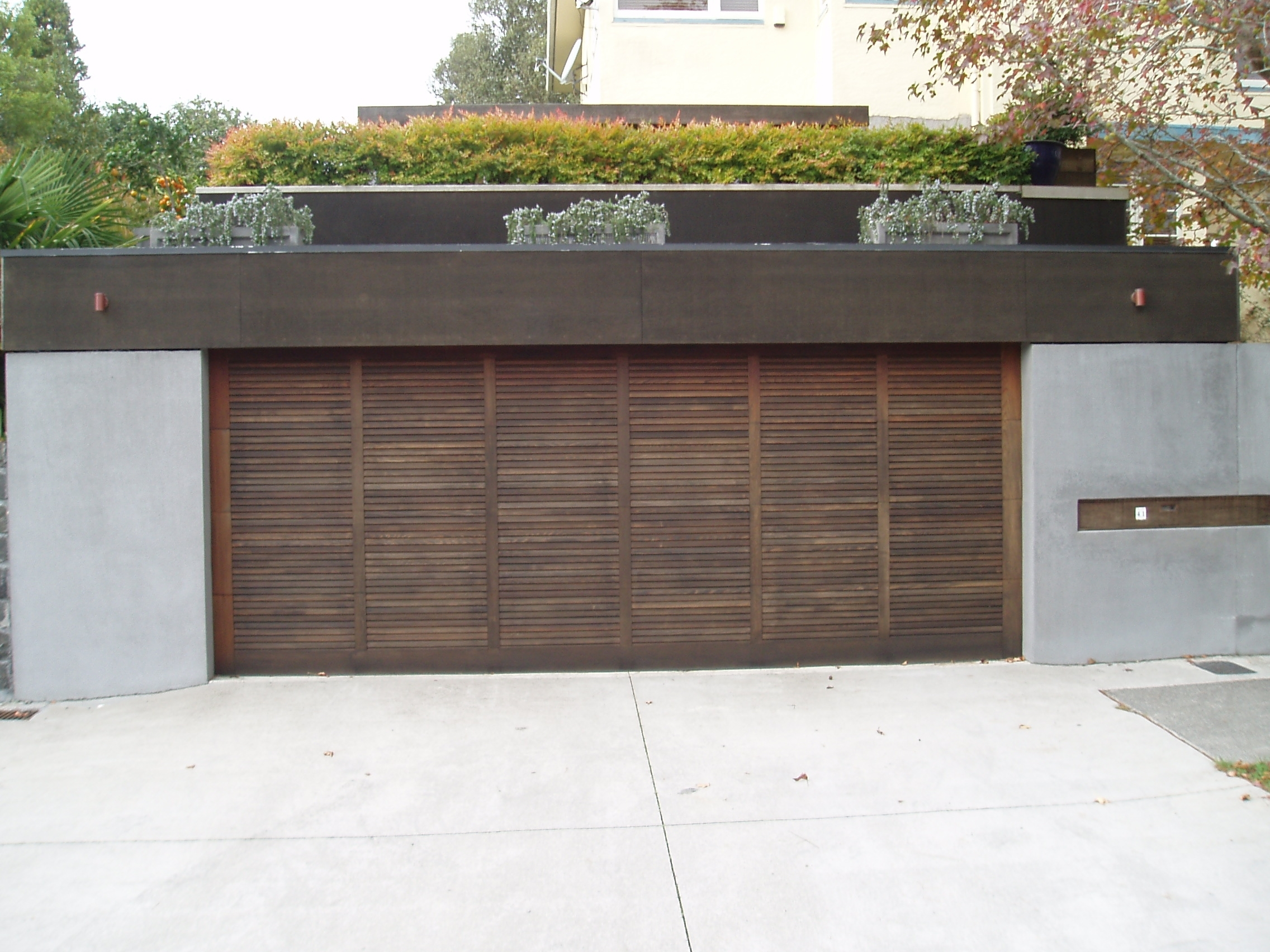 louver style cedar sectional door