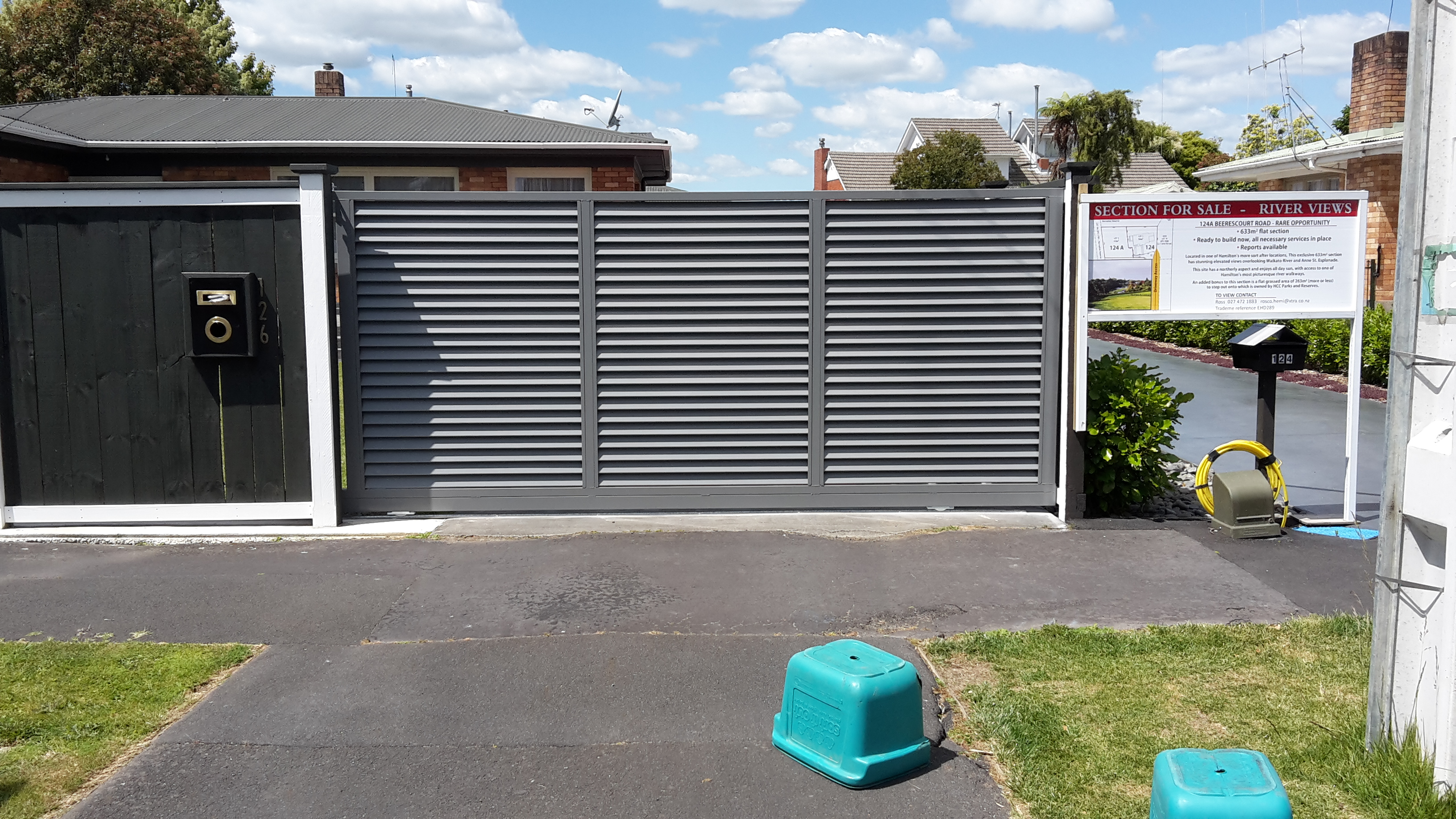 Angled louvre style sliding gate