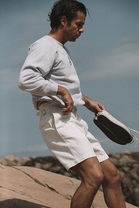 Pierre Saint Marie for Casatlantic wearing white cotton shorts.