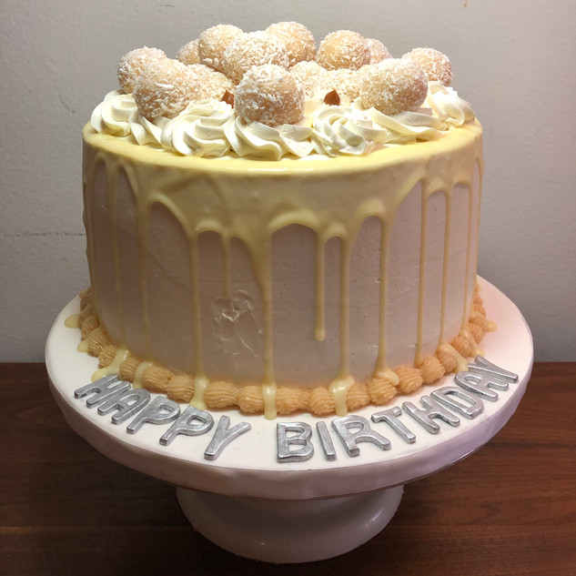 Coconut white chocolate dripping Cake