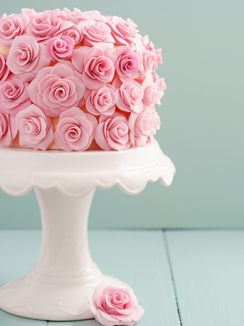 bigstock-Cake-with-sugar-roses-116872355