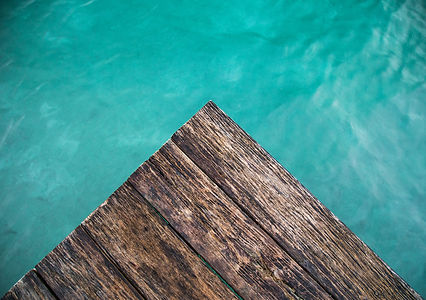 The blue lagoon of Bacalar and a dark, old wooden pier peeking out into it. Best photo ever made.
