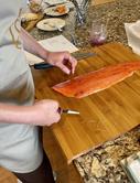 Removing pin bones from salmon