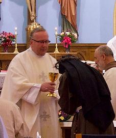 priest eucharist.jpg