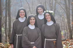 four sisters outside