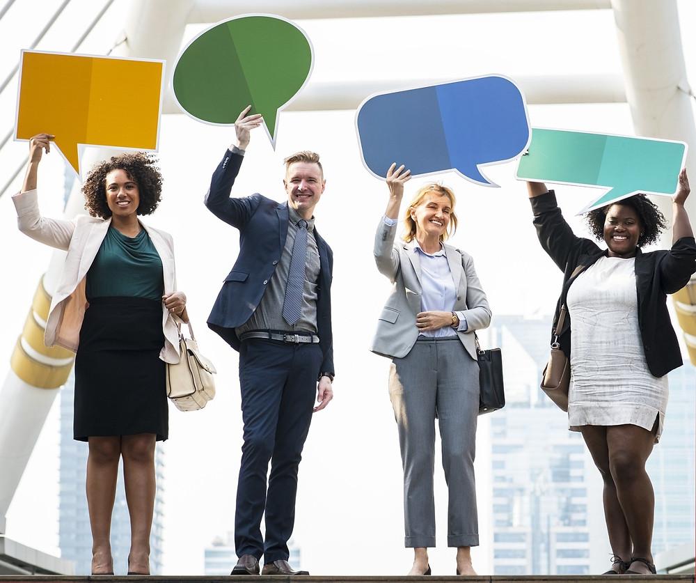 Diverse Group Holding Chat Bubbles