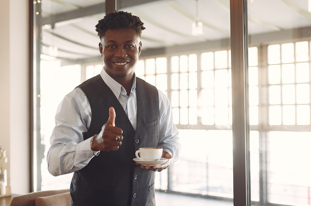 Man With Cup of Tea, Giving Thumbs Up
