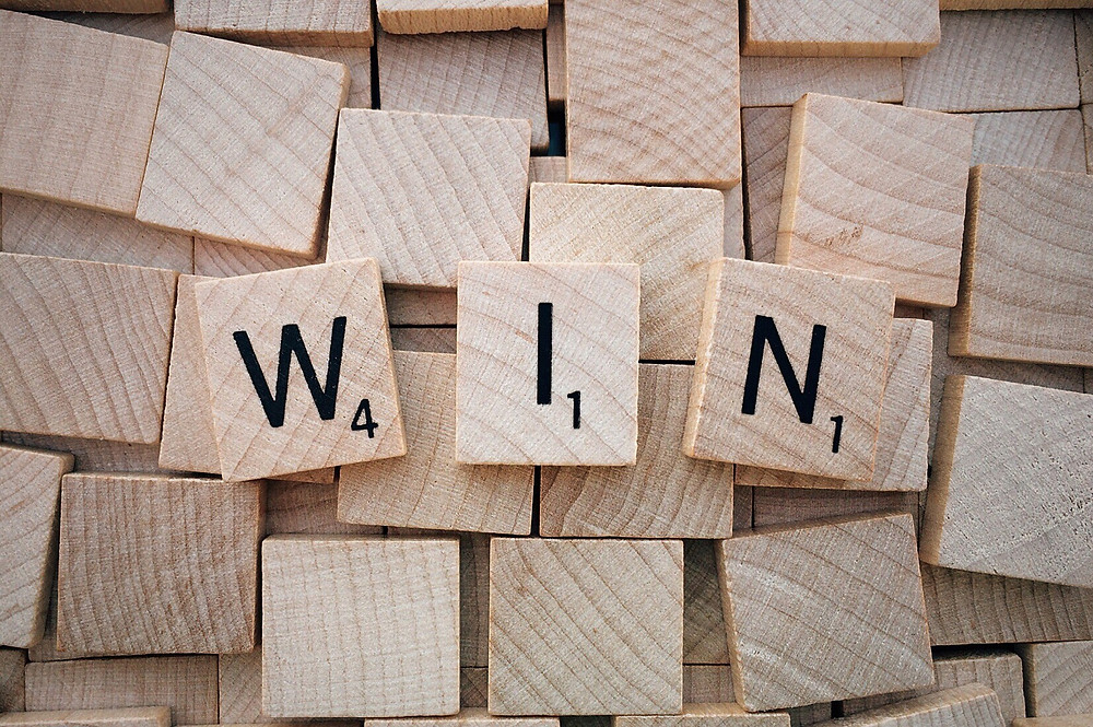 Scrabble Pieces with the Word Win
