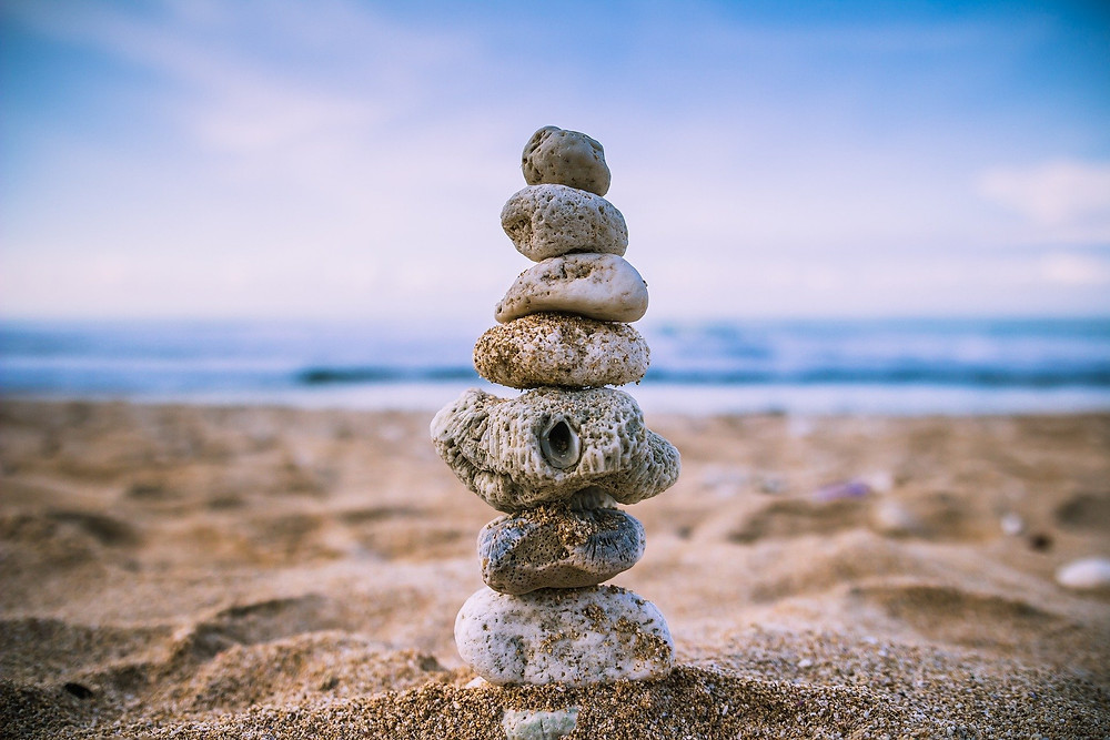 Stones Balanced on Top of Each Other on a Beach