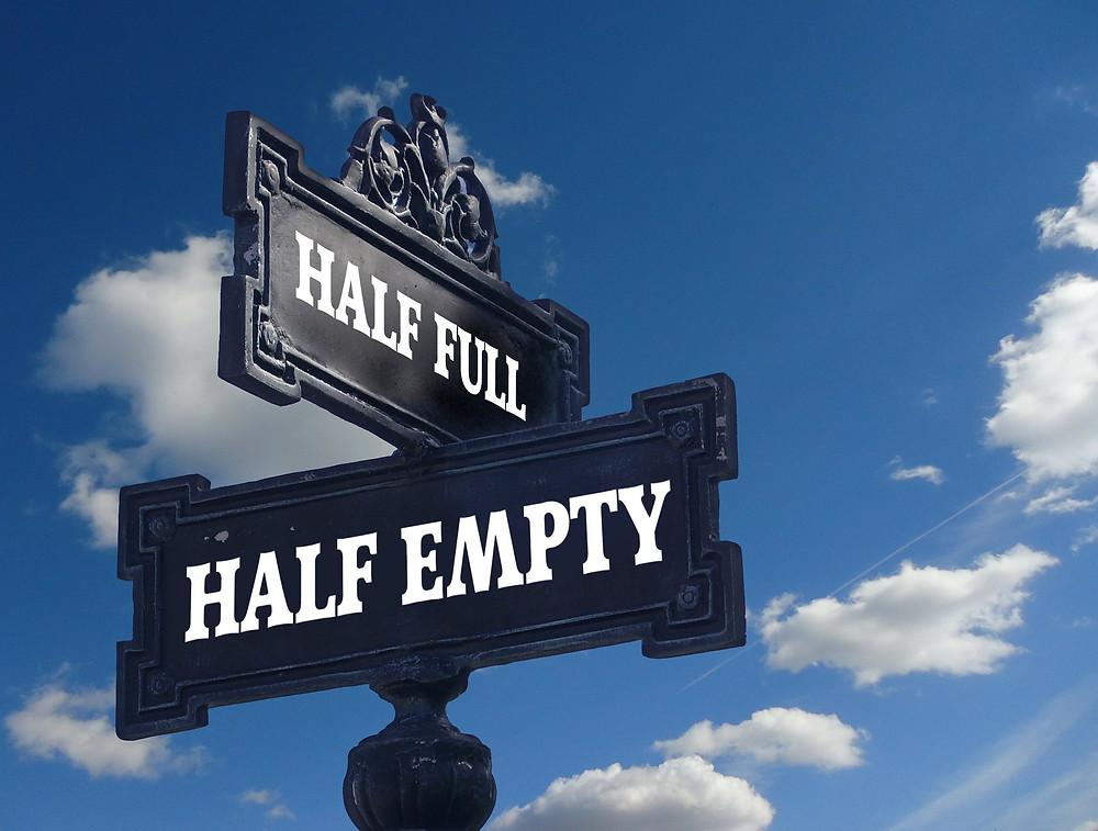 Two Signs Half Empty Half Full