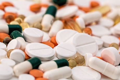 bunch-of-white-oval-medication-tablets-a