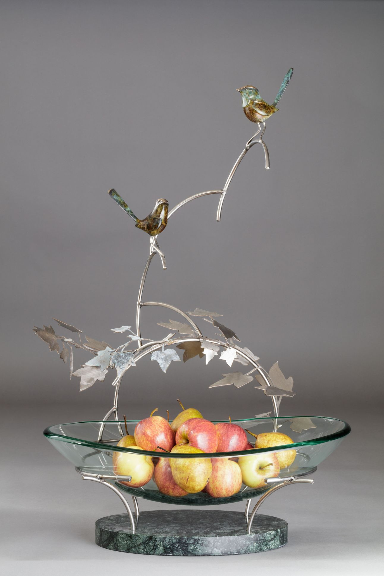 Wrens on a fruit bowl