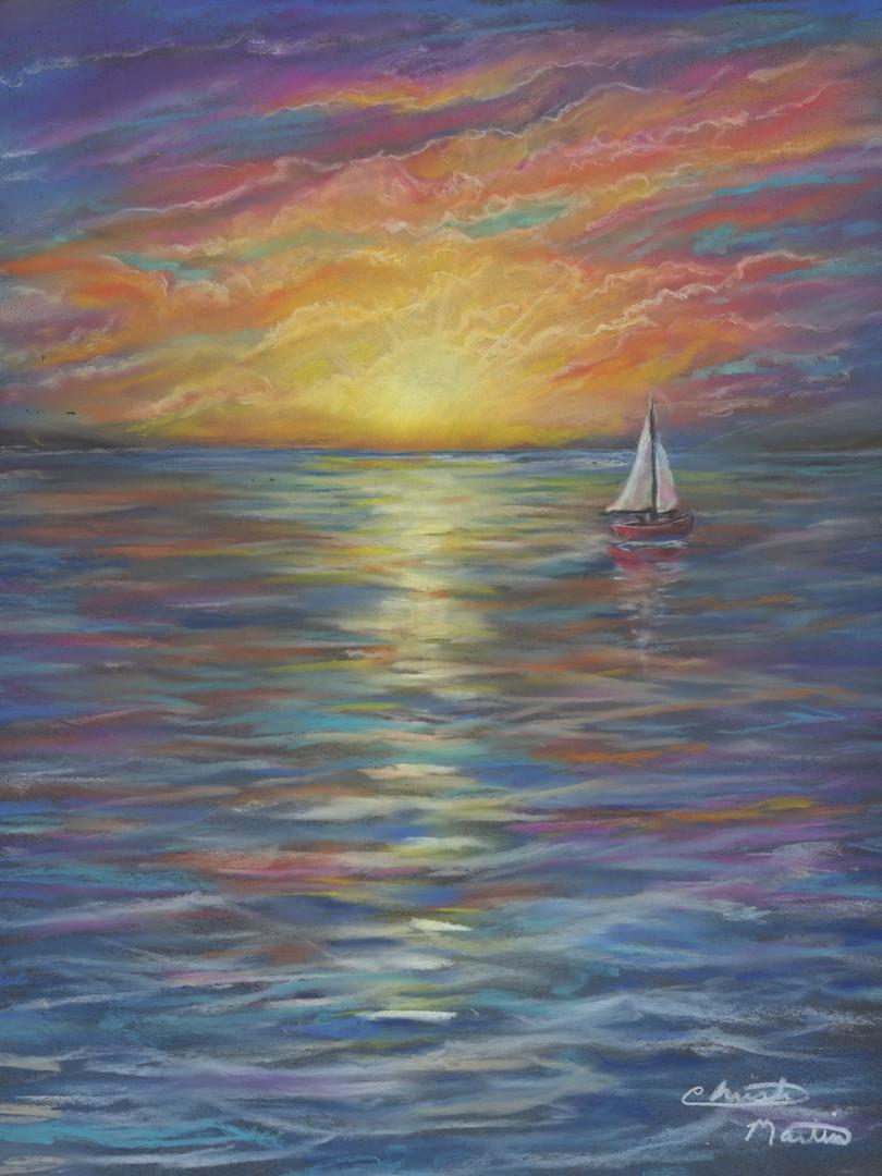 Tiny sailboat at sunset