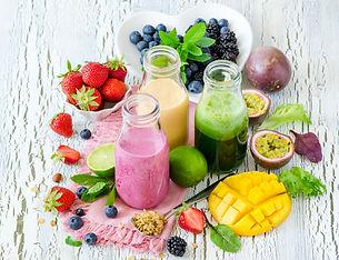 Berry and fruit smoothie in bottles, healthy summer detox yogurt drink, diet or vegan food