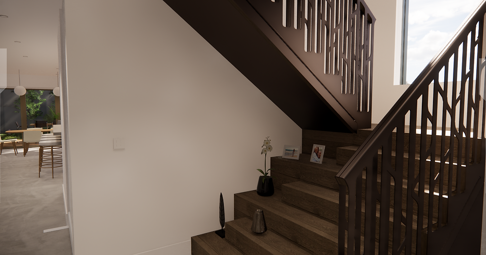 A staircase leading up to the right and a glimpse of the kitchen and dining room to the left.