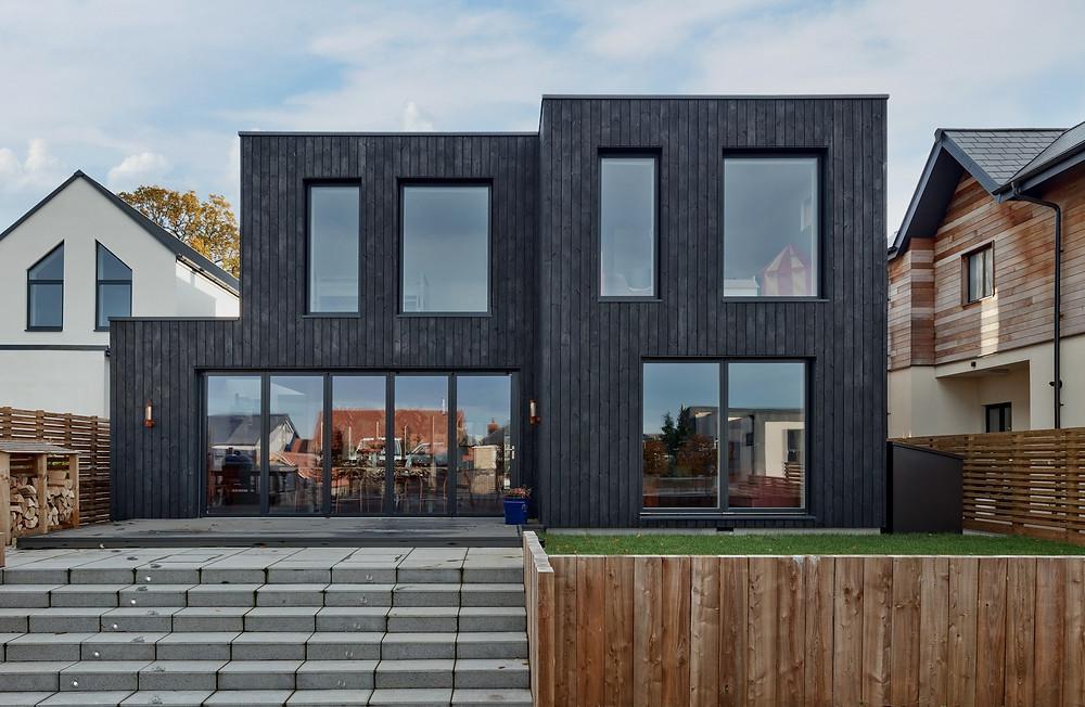 A black timber home.
