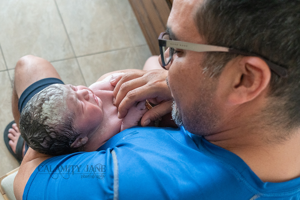 Las Vegas Birth Photographer Calamity Jane captures the first moments after baby is born.