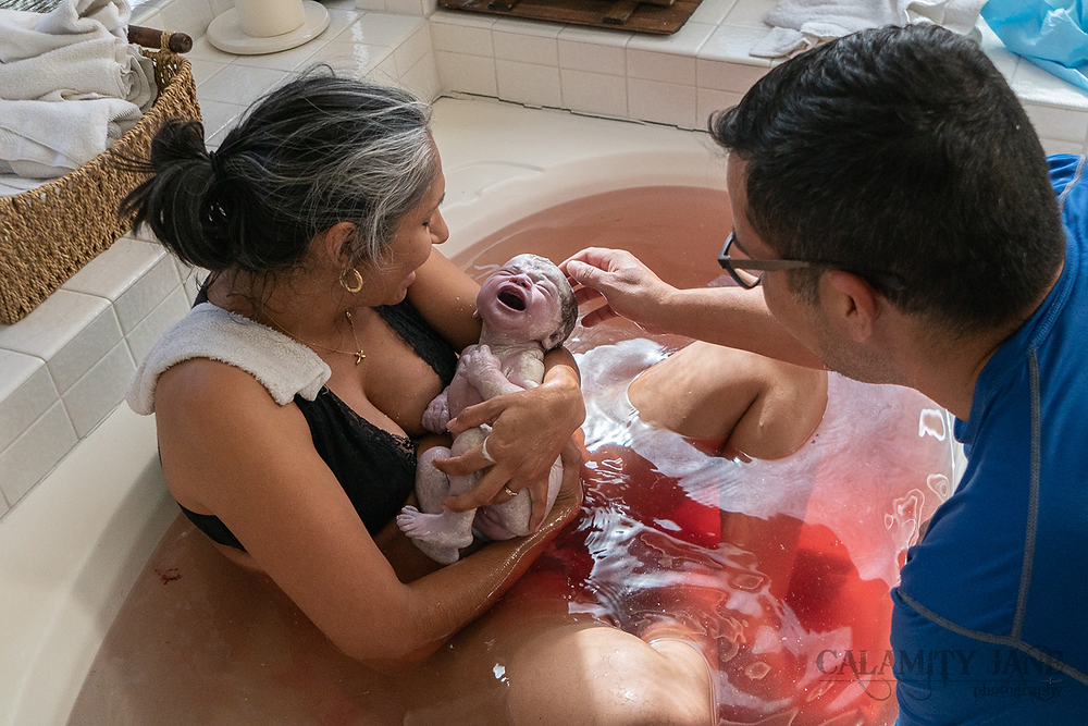 Las Vegas Birth Photographer Calamity Jane captures the first moment after baby is born.