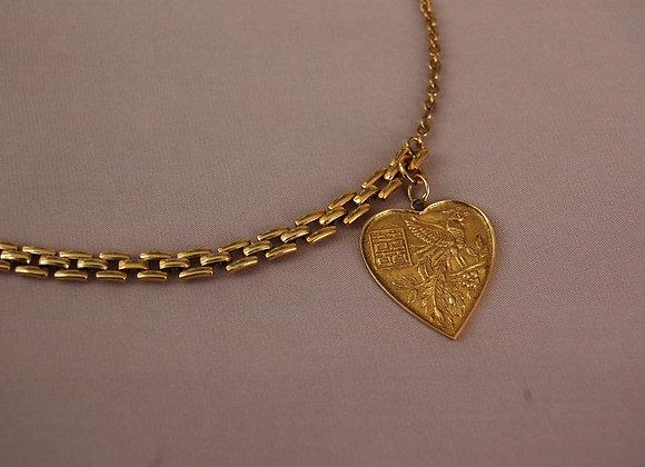 Collier ras-du-cou asymétrique orné d'un pendentif cœur en or