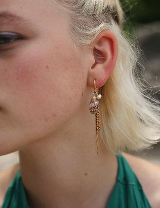 Boucles d'oreilles asymétriques chaînes et coquillage