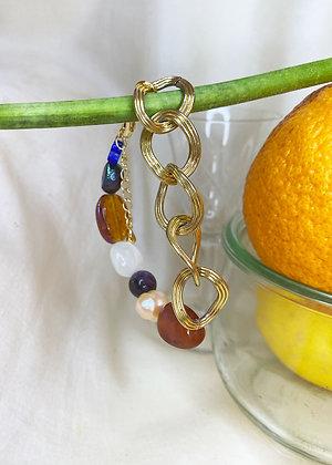 Bracelet asymétrique orné de pierres multicolores