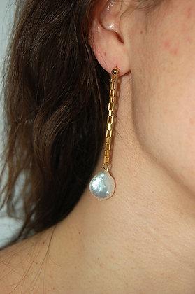 Boucles d'oreilles longues ornées de perles