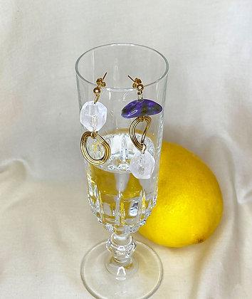 Boucles d'oreilles asymétriques pendantes ornées de pierres