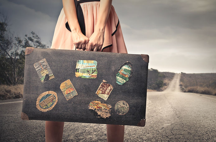young woman with a vintage suitcase in t