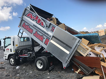 Action Junk Removal truck dumping junk and debris at the Clearwater fl landfill