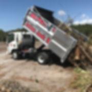 Action junk removal dump truck full of yard waste,haul yard waste,hauling yard waste,brush loading and hauling